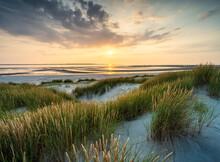 Sunset On The Dune Beach