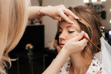 Shooting In A Beauty Salon. Makeup Artist Prepares The Bride Before The Wedding In The Morning