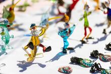 Closeup Photo Of Original Colorful Miniature Figures From Glass