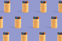 Colored Crayons Pattern Composition On Pastel Purple Background. Waxy Pencils Eco Cardboard Box Isometric. Colorful Wax Pastel Paper Case Writing Art Drawing. Back To School Artistic Education Concept