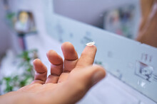 Person With Contact Lens On Finger