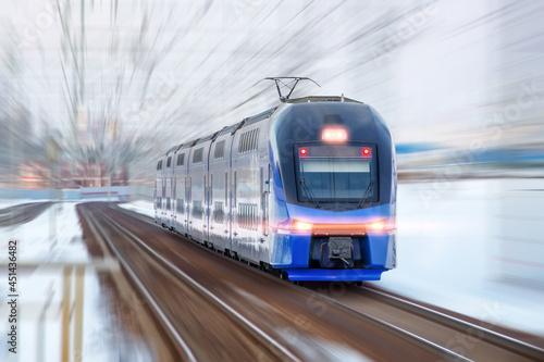 Obraz na plátně Modern high speed train in motion blur. Passenger Transportation.