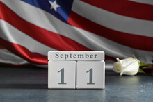 Calendar With Date Of National Day Of Prayer And Remembrance For The Victims Of The Terrorist Attacks On Table Against USA Flag