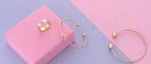 Knot Shape Modern Bracelet And Ring On Pink And Purple Background With Copy Space