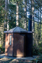 Small Camping Yurt Under Forest Canopy Next To Trail