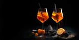 Aperol spritz cocktail served on dark background.
