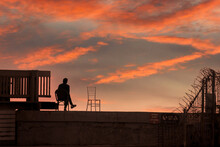 A Man Watching The Sunset At TLV Port