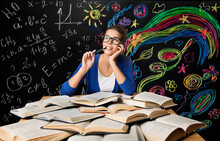 Student Creative Education. Young Woman Learning Arts Mathematics Formula. Brain Development Concept In Chalk Drawings Over Blackboard