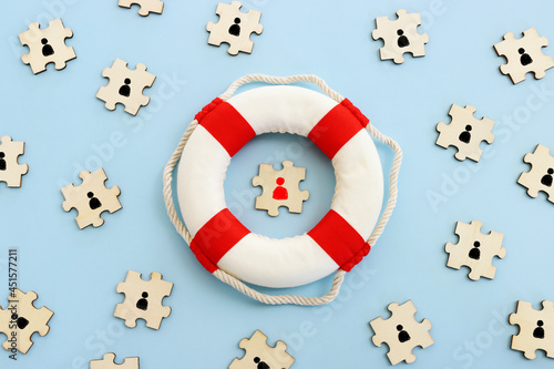 Concept image of life buoy protecting group of people. Rescue and support in times of crisis metaphor