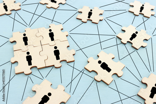 business concept image of puzzle blocks with people icons ,human resources and management concept
