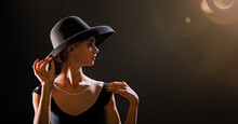 Romantic Portrait Of Beautiful Young Girl On A Black Background In An Elegant Hat