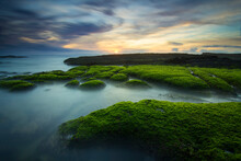 Magoito Beach At Sunset With Rocks Covered With Moss - Sintra, Portugal - Long Exposure