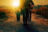Fototapeta Kawa jest smaczna - soldier with long rifle gun walking on dirt battle field