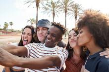Young Interracial Friends Take A Picture Playing Fool. Group Of People Enjoying Their Free Time Together.