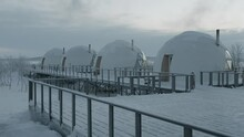 Row Of Igloo Dome Houses With Glass Panoramic Windows Standing On A Wooden Platform In Glamping On A Winter Day
