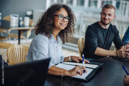 Female entrepreneur having meeting with team