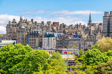 A View From Princes Street Gardens Towards The Buildings In The Lower Part Of The Royal Mile In Edinburgh, Scotland On A Summers Day