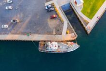 Aerial View Of A Fishing Trawler Tied Up At A Dock Near A Slip Way
