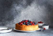 Vanilla Pie With Raspberries, Blueberries On The Kitchen Table With A Cup Of Coffee. Cheesecake With Berries.