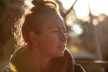 Horizontal Shot Of Woman With A Messy Bun Hairstyle Looking From A Far On A Sunny Day