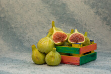 Sliced Fresh Figs In Wooden Box