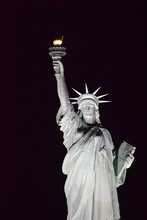 Statue Of Liberty Close Up In The Night With Black Background