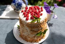 Raspberry Homemade Cake On Table In Garden On Sunny Summer Morning. Summer Vacation Concept