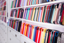 Different Mobile Phone Cases On Shelves In A Multimedia Store
