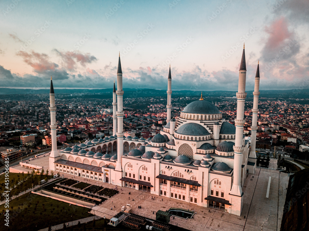 Suleymaniye Mosque surrounded by buildings in the evening in Istanbul, Turkey