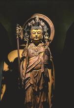 Beautiful Details Of A Golden Standing Buddha Sculpture At A Buddhist Temple In Kamakura, Japan