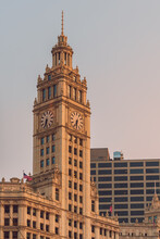 Vertical Shot Of Wrigley Building's Clock Tower Under A Clear Sky In Chicago, USA