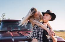 Stylish Couple Hugging Near Vintage Car