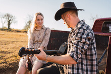 Couple With Guitar Sitting In Vintage Pickup Truck