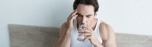 Unwell Man Touching Head And Drinking Water While Suffering From Migraine, Banner