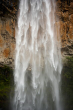 Water Rushing Down Over Rocks At Purlingbrook Falls