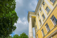 Old Big School House With Columns And Sky