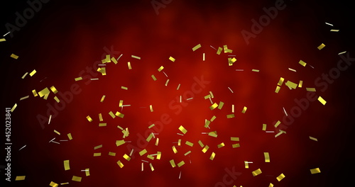 Image of golden confetti falling over glowing red background