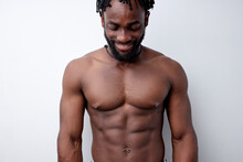 Happy Cheerful Bodybuilder Enjoy Life, Having Good Mood, Posing Isolated On White Studio Background. Portrait Of Muscular Shirtless African Guy Copy Space. People Lifestyle, Bodybuilding Concept