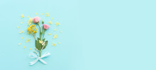 Top View Image Of Pink, Yellow And Purple Flowers Composition Over Pastel Blue Background .Flat Lay