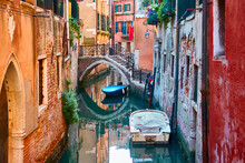 Canal With Bridge And Boats In Venice