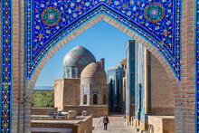 View Over The Mausoleums And Domes Of The Historical Cemetery Of Shahi Zinda Through An Arched Gate, Samarkand, Uzbekistan