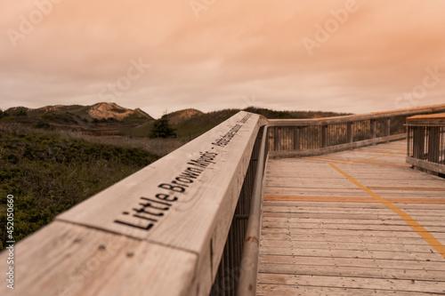BRACKLEY, CANADA - Jun 27, 2021: Closeup shot of a wooden bridge in a Brackley beach in Prince Edward Island, Canada