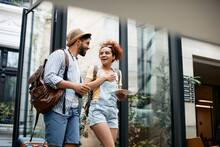 Young Woman And Her Boyfriend Feel Happy As They Arrive At The Hotel.