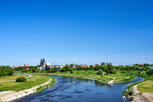 The Warta River And Bell Towers Of The Historic Gothic Cathedral