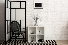 Interior Of Stylish Living Room With Chest Of Drawers