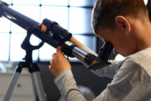 Little Boy With Telescope Looking At Stars In Evening