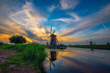 Sunset Above Historic Windmills In Kinderdijk, Netherlands