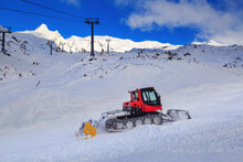 A Snow Groomer (tracked Vehicle With A Dozer Blade) At Work On A Ski Field. Photographed At Whakapapa Ski Area, Mount Ruapehu, New Zealand