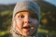 Child face close up cute baby wearing hat 2 years old kid traveling outdoor family vacations