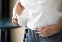 Coffee Stomach Ache. Digesting Acid Pain